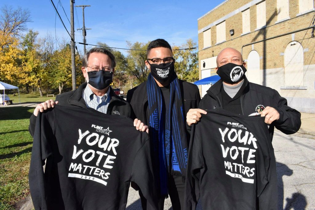 Your Vote Matters! U.S. Senator Peters, Event Organizer Levi Todd, City of Flint Mayor Neeley.