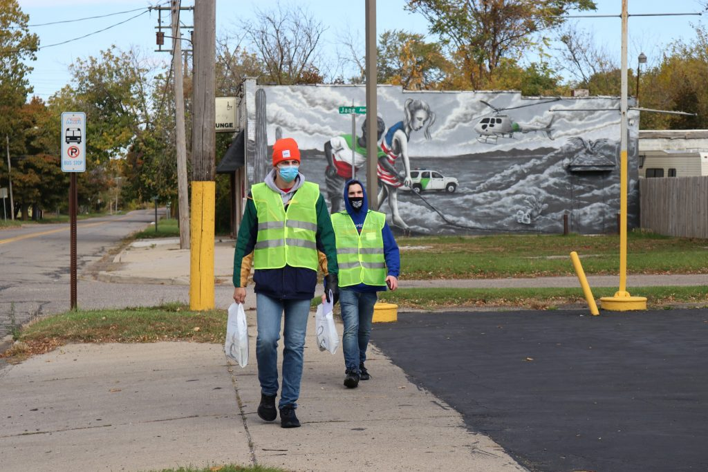 Volunteers walking through the Eastside on Lewis St.