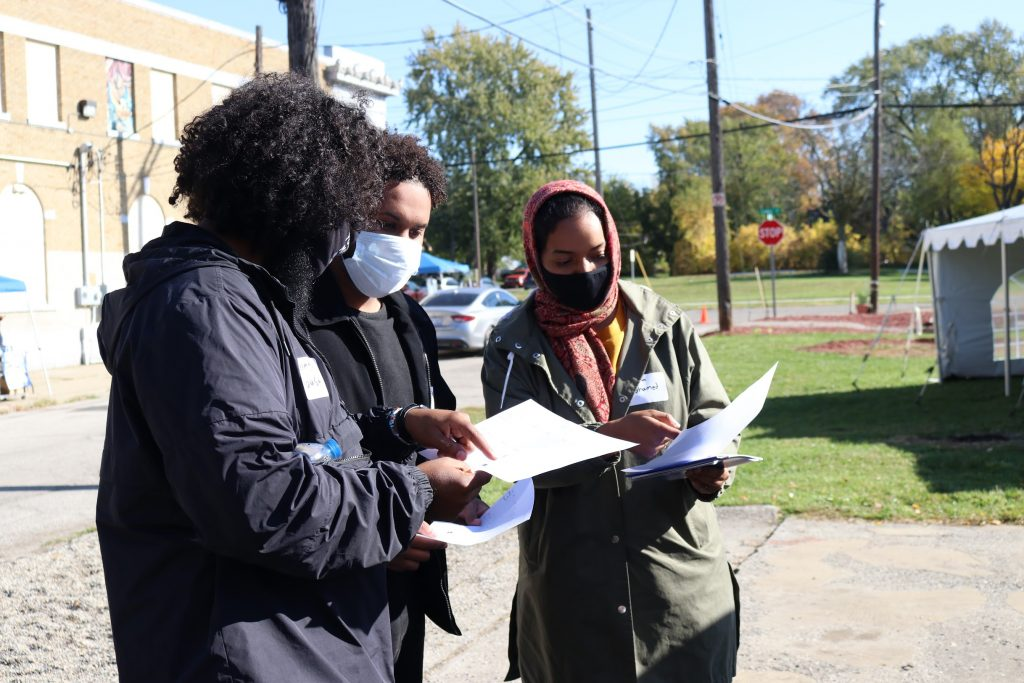 Volunteers reviewing Flint area map